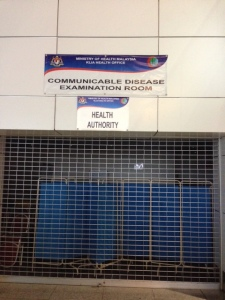 Infection control station at the airport in Kuala Lumpur.
