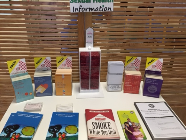 Educational pamphlets and a stack of free condoms just within the main entrance of the clinic.