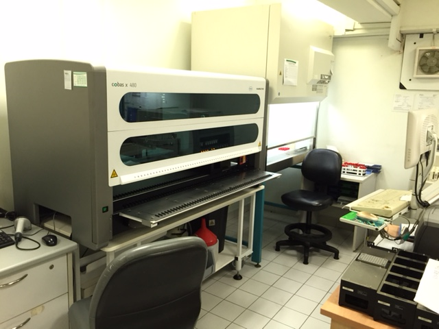A view of the laboratory within Kelantan clinic, showing the automated Cobas molecular testing system from Roche.