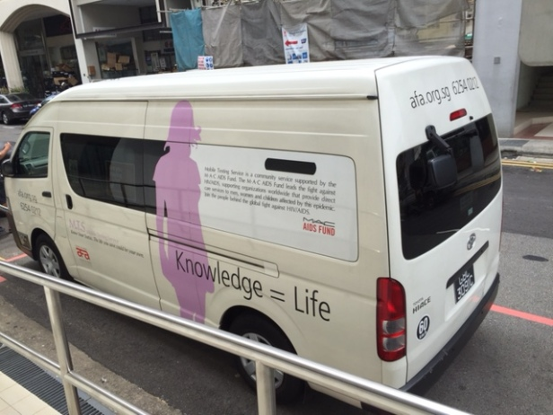 An Action for Aids mobile testing van, parked outside DSC Clinic.