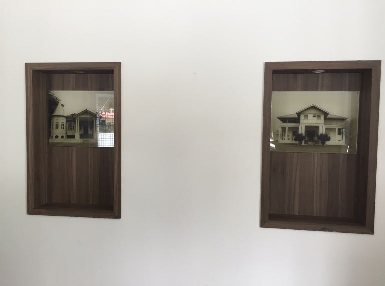 Stills of the old buildings, mounted inside the old bungalow.