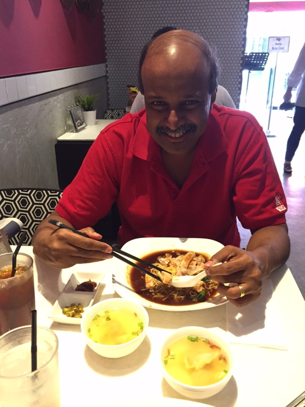 Prof. Paul Tambyah having chicken ipoh hor fun at a well known Holland Village restaurant.
